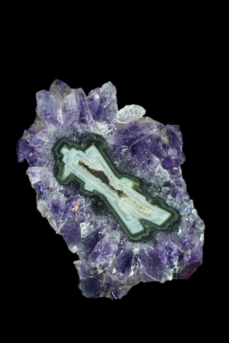 'x' shaped pseudomorph covered n amethyst crystals.